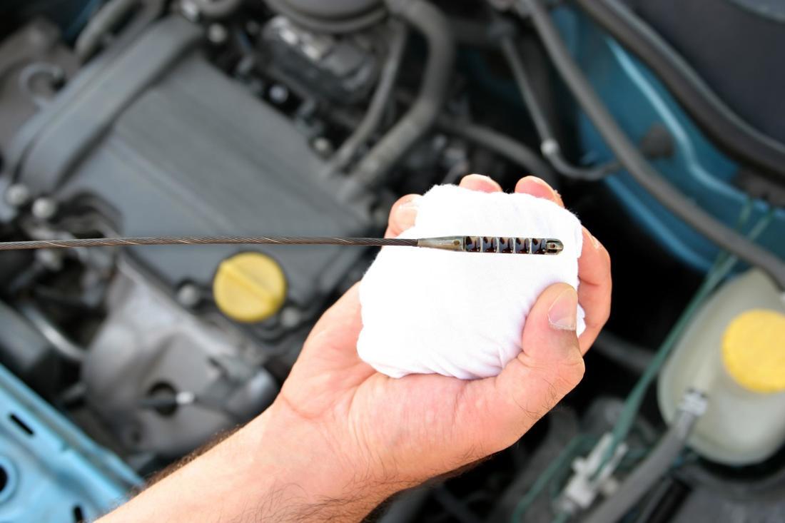 Mechanic checking the oil dipstick